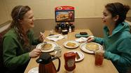 Anna Wahlstrom, left, and Sarah Becouvarakis enjoy free pancakes