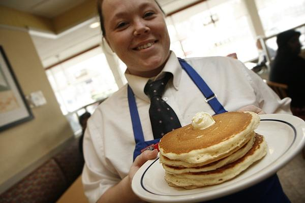 Amanda Surber serves a stack of free pancakes at the IHOP on Jefferson Avenue on Feb. 5 for National Pancake Day to support the Leukemia and Lymphoma Society.