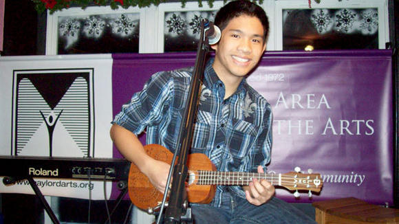 Alphonse Buclay is happy to play his ukulele and share a song at the recent Northern Stars Open Mic contest.