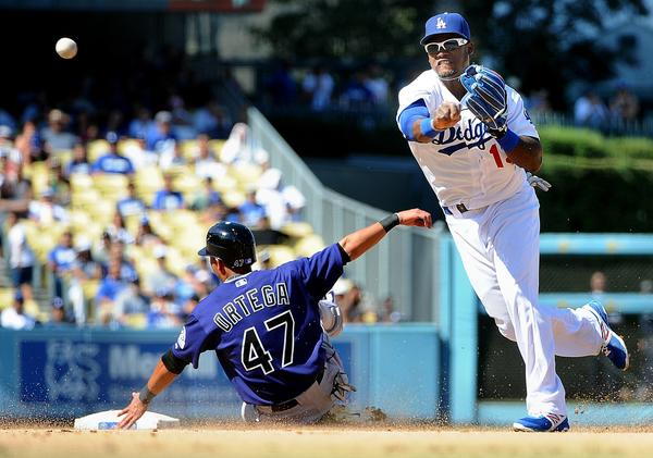 The Rockies' Rafael Ortega is out at second base at the hands of Hanley Ramirez, during a double play at Dodger Stadium.