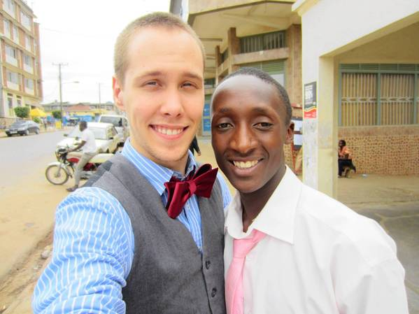 Carl Chomko, left, with his roommate, Dancan, in downtown Mbarara in Uganda.
