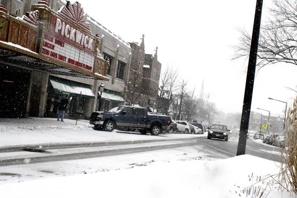Snow falls along Prospect Avenue Tuesday in Park Ridge. City officials say part of a roughly $840,000 transportation grant could be used for streetscape improvements along Prospect.