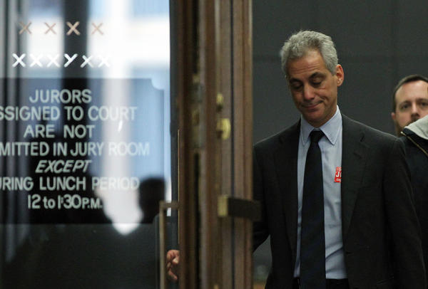 Mayor Rahm Emanuel, left, walks into a courtroom with fellow potential jurors at the 17th floor of the Daley Center today. The pool of potential jurors was dismissed, and Mayor Emanuel received a check for $17.20 from Cook County, which he plans to donate back to the county, according to spokespeople.