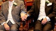 LONDON -- British lawmakers voted Tuesday to allow gay and lesbian couples to wed, siding with majority opinion in the country but exposing major divisions within the ruling Conservative Party.