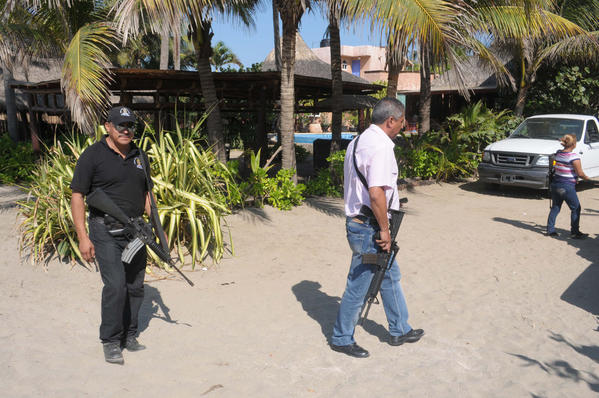 Police patrol in Acapulco, Mexico, a day after gunmen raped six Spanish tourists inside a home.