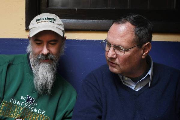 Jeff Skrentny, left, shows photos to David Johnson at the first Birds & Beers bird-watchers gathering, at the Duke of Perth pub last month.