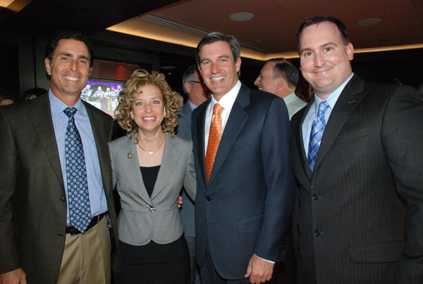 "Society Scene photos - Alan Hooper, left, Congresswoman Debbie Wasserman-Schultz, Robert Lochrie and James Abril at the 18th annual ""Broward County Transit Luncheon"" hosted at the Broward Center for the Performing Arts by the Downtown Fort Lauderdale Transportation Management Association (TMA) Executive Board."