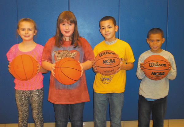 The winners of the Winter Street Elementary schoolwide hoop shoot contest, from left, Amber Kegarise, Kymberley Schwartz, Jose Rodriguez and Manuel Black.