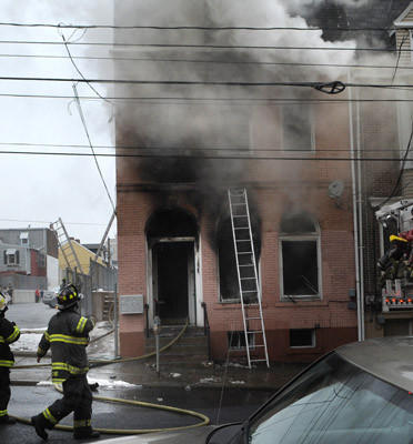 Allentown firefighters battle a blaze at a house at 4th and Linden Streets Tuesday afternoon.