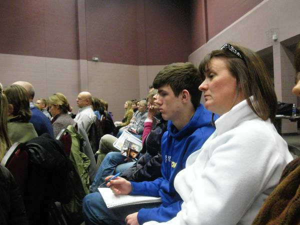 Susan Todd and her 16-year-old son, Billy, were among more than 100 people who showed up at Monday night's forum in Wheaton on the suburban heroin epidemic.