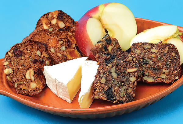 These crackers cranberry-apricot-cashew crisps, left, and fig-olive-pecan crisps, right, are twice baked, like melba toast or biscotti, and go well with soft cheese and fresh fruit.