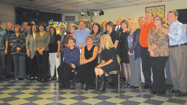 The Smithsburg High Class of 1977 held its 35-year reunion Oct. 6 at the Cascade American Legion. Row one, seated, Rea Ridenour, Robin Evans and Rita Black. Row two, standing, Kenton Taylor, Sharon Mertz, Teresa Mellot, Charlotte Pryor, Amy Bender, Lynly Long, Mike Stoner, Lisa Toms, Donna Shank, Debbie Tracey, Lenny Bob Day and Terri Deneen. Row three, Danny Langdale, Bill Dauphin, Tony Warren, Barb Kendle, Susan Kendle. Mike Dayhoff, Ruth Little, Linda Harris, Joenda Youngblood, Mike Harbaugh, Randy Longnecker, Randy Thompson and Eric Webber. Also in attendance were Paul Rumbaugh, Alex Plowman, Gary Tippitt and Todd Bowser, but they are partially hidden in the photo.