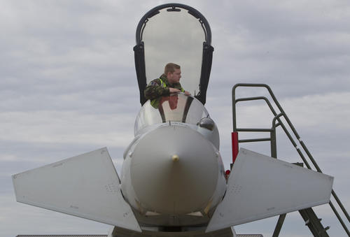 Dan Langton, a member of the maintenance crew of Royal Air Force XI Squadron, performs checks on a Typhoon aircraft prior to a flight exercise at Langley Air Force Base in Hampton on Tuesday.