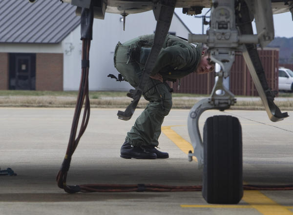 A member of the Royal Air Force XI Squadron performs last-minute checks on a Typhoon aircraft prior to a flight exercise at Langley Air Force Base in Hampton on Tuesday.