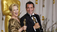 Meryl Streep and Jean Dujardin pose with their awards at the 84th Annual Academy Awards