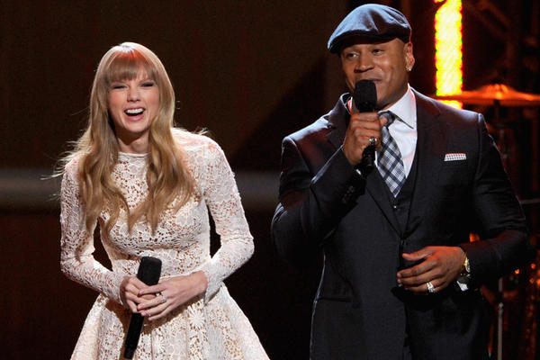 Singer Taylor Swift, left, and rapper LL Cool J perform onstage at The Grammy nominations concert at Bridgestone Arena on December 5, 2012 in Nashville, Tenn.
