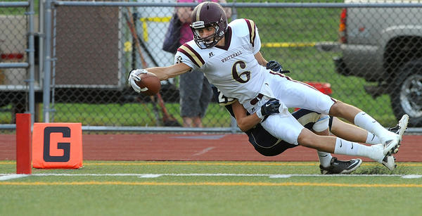 Whitehall's WR Nick Sommer (6) (front) tries to stretch for the goal line as he is dragged out of bounds by Spring-Ford's Jared Shoemaker (29) (back) during the first quarter at Coach McNelly Stadium Friday night.