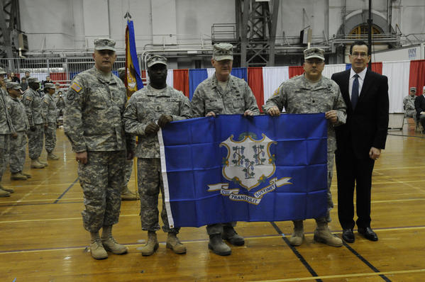 Gov. Dannel P. Malloy presented the state flat at the Connecticut National Guard send-off ceremony for 70 soldiers of the 143rd Combat Sustainment Support Battalion of Waterbury