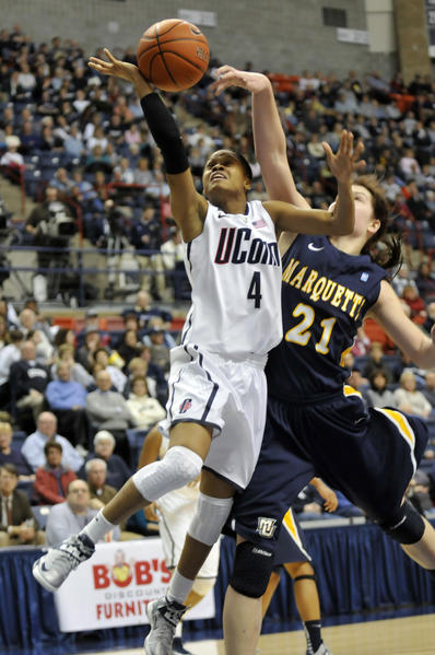 Connecticut Huskies guard Moriah Jefferson (4) is fouled by Marquette University forward Katherine Plouffe during the first half at Gampel Pavilion Tuesday night. UConn leads 62-17 at the half.