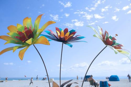 Flowers designed by Celestial Iron Works artist Kelvin Schartz are displayed along the Hollywood Beach Broadwalk during the Seaside Craft Fair.