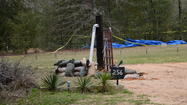 The man who kidnapped a 5-year-old Alabama boy and held him hostage reportedly died in a shootout with rescuers and had bombs in his bunker.
