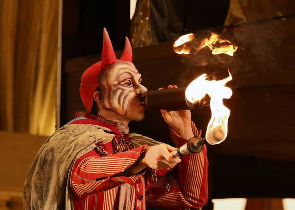 Actor Wesley Daniel begins a flame-blowing stunt Monday during a dress rehearsal of Lyric Opera of Chicago. This one was successful, but a later try burned him.