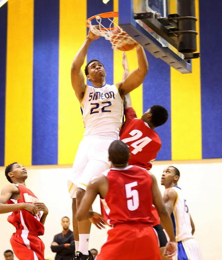 Simeon's  Jabari Parker dunks in front of Urban Prep West's Jordan Huff during the first half of  a first-round Public League tournament game at Simeon on Tuesday.