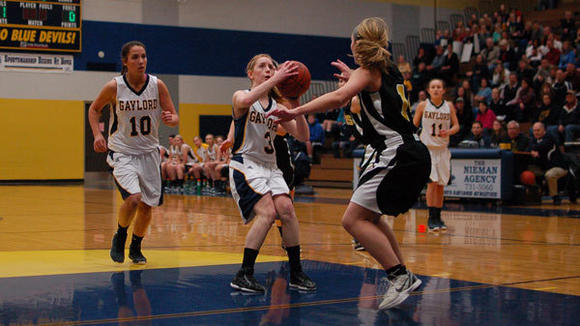 Mackenzie Edwards (3) steps for her 1,000 career point during Tuesday's 58-50 Gaylord victory over TC Central.
