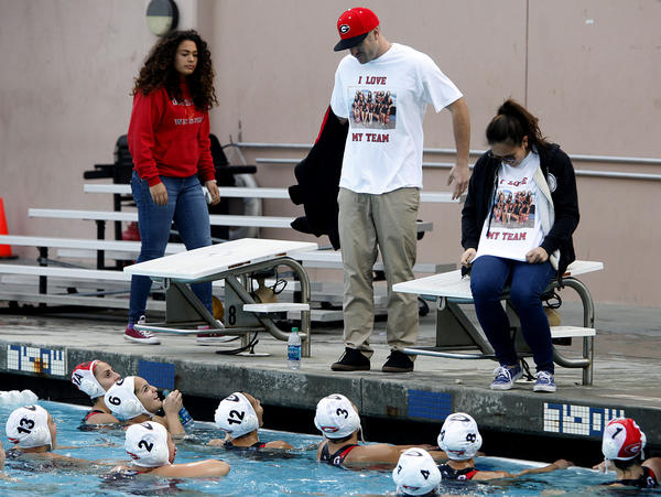 Glendale High School's head water polo coach Forest Holbrook shows his love for his team with a home-made T-shirt just before game vs. Burroughs High in Pacific League Tournament game at Burbank High School in Burbank on Tuesday, February 5, 2013.  Burroughs won the game 5-2.