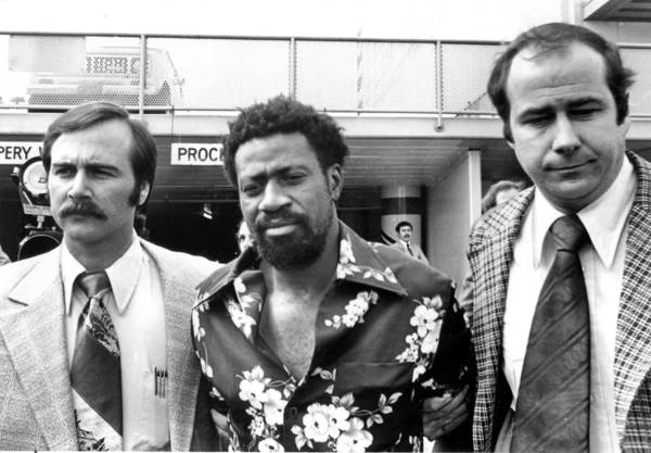 Bobby Joe Maxwell, center, is flanked by detectives on his way to a court hearing in 1979.