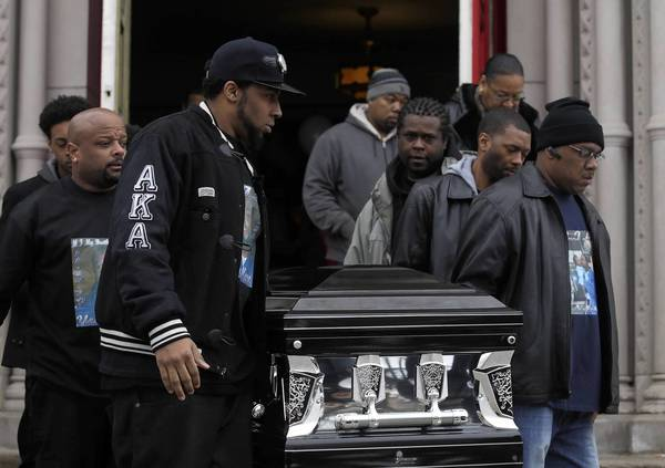 "Norman Dumone ""Mone"" Stokes' casket is carried to a hearse during his funeral Tuesday."