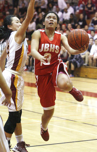 Burroughs' Sidney Ortega is fouled as she shoots to score a layup against Arcadia's Melody Chang in the second quarter in a Pacific League girls basketball game at Arcadia High School on Tuesday, February 5, 2013.