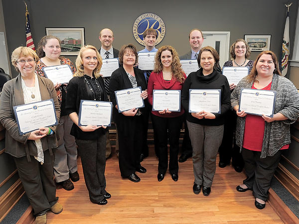 The Berkeley County Board of Education on Tuesday recognized 11 teachers in the county school system who recently earned their National Board certification. They are from left: Cindy Evarts, Gina Pratt, Sherrie Hartman, Kevin Frankhouser, Sandy Marchese, Anthony Ponton, Kelly Kable, Mark Albright, Magdalene Frye, Jessica Ruqus and Erin Peralta.