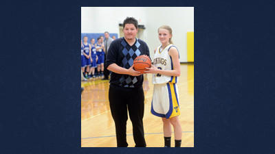 Kayla Stockenus receives the game ball from Shanksville coach Corey Nau. Stockenus surpassed the 2,000-point plateau on Tuesday.
