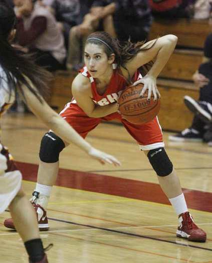 Bailee Trotta of Burroughs High looks for an opening against Arcadia.