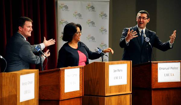 L.A. mayoral candidates from left, Kevin James, Jan Perry and Emanuel Pleitez react to a question during a debate at Loyola Marymount University Tuesday night.