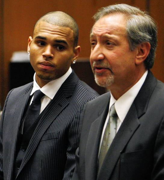 Chris Brown, left, is shown with his attorney, Mark Geragos. The singer is required to perform 180 days of community labor in connection with a 2009 attack on then-girlfriend Rihanna.