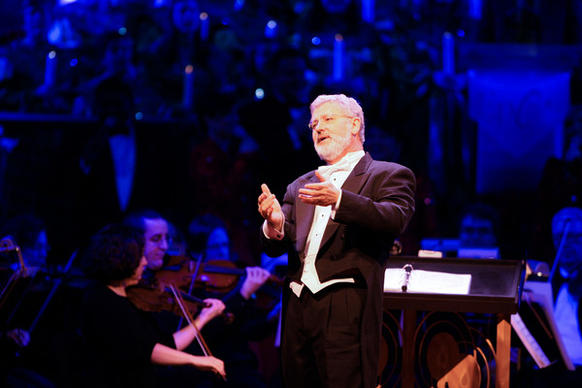 Conductor Dr. John Sinclair directs the audience during the Disney Candlelight Processional at the Epcot park on Thursday December 16, 2010 in Orlando, Fla.