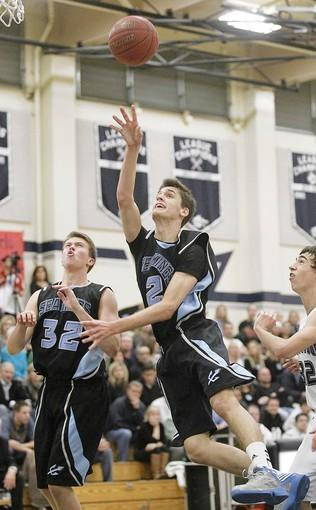 Corona del Mar High's Blake Grable, center, attempts to score during the first half against Northwood in a Pacific Coast League game on Tuesday.