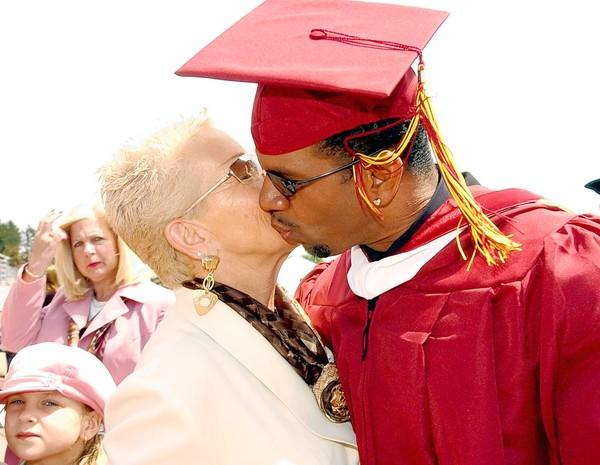 Andre Reed, a few credits shy of a Kutztown University degree when drafted by the Buffalo Bills in 1985, gets his diploma in 2005 and a kiss from his mother, Joyce.