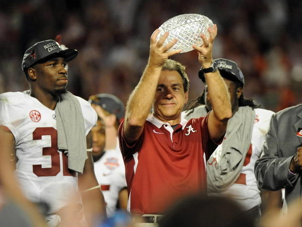 Alabama head coach Nick Saban hold the trophy aloft following a 42-14 win against Notre Dame in the BCS National Championship game at Sun Life Stadium in Miami Gardens, Florida, on Monday, January 7, 2013. (Jim Rassol/Sun Sentinel/MCT)