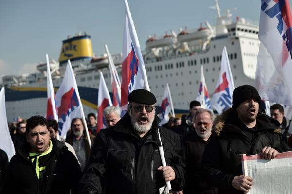 Union members protest at Greece's main port, Piraeus, near Athens, as the government invokes emergency powers to end a crippling seamen's strike.
