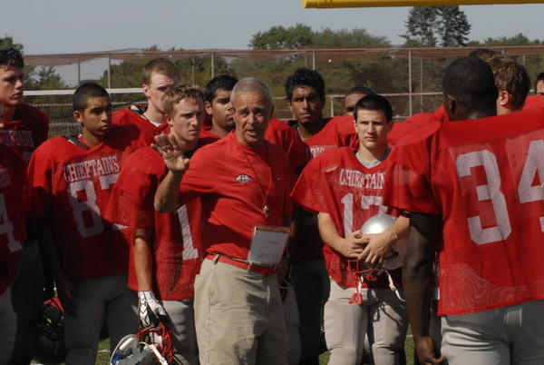 Coach Rob Cersosimo talks to his team before a scrimmage against Glastonbury Aug. 27, 2008