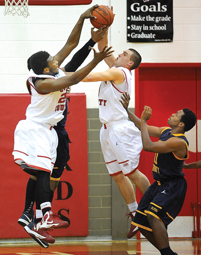 George Rogers Clark's Khamarkis Blanton, left, and teammate Riley Caudill, right battle for a rebound in the Cardinals' 48-41 win over Franklin County Tuesday night at Norton Gymnasium.
