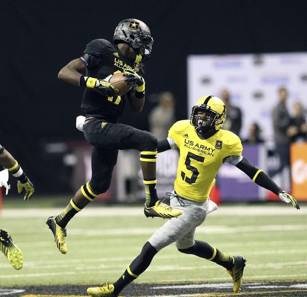 UCLA signee Tahaan Goodman (5), a safety from Rancho Cucamonga High School, closes in to make the tackle on James Quick of Louisville, Ky., in the 2013 U.S. Army All-American Bowl high school football game.
