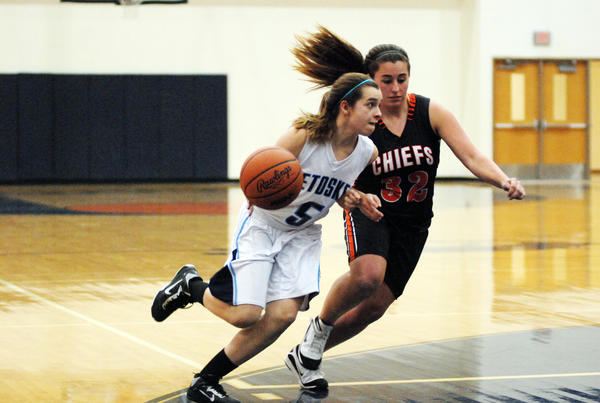Petoskey senior guard Liz Fraser (left) drives around Cheboygan senior Mariah Rozek during Tuesday's non-league contest at the Petoskey High School gym. The Northmen defeated the Chiefs, 47-16, to improve to 14-2 overall. The win was also Petoskey's 11th straight.
