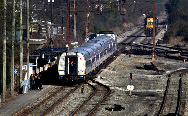 The morning Amtrak train moves through the switching area around coal cars near to the current Amtrak Station in Newport News.
