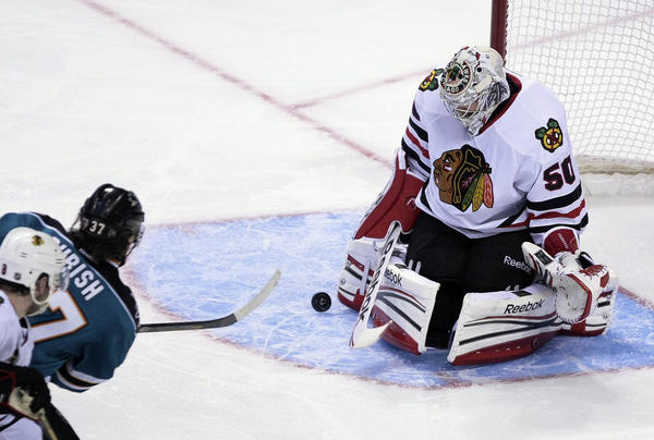 Corey Crawford stop a shot Tuesday night against the Sharks.
