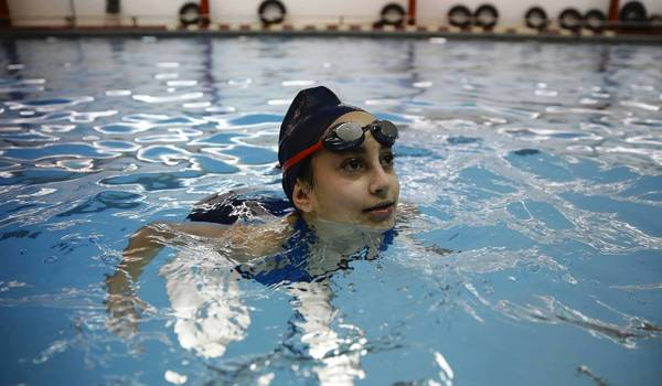 At Deerfield High School, freshmen girls, including Liat Berkowitz, take a swim class Monday, Feb. 4 in the pool, which teachers say is too small to accommodate their large classes swimming lengths together.