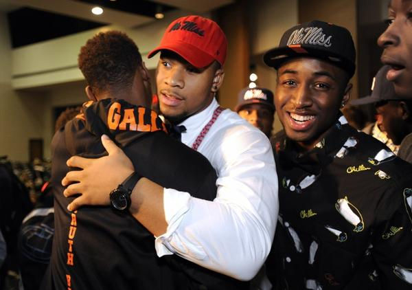Robert Nkemdiche, center, is congratulated after his announcement to play college football at Mississippi.